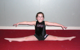 Empire student demonstrates a straddle split
